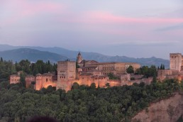 Watching the sunset behind the Alhambra in Granada - Bare Escape
