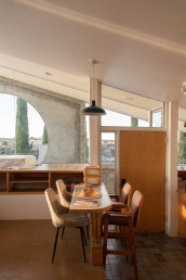The interior dining area of the Sky Suite AirBnb at Arcosanti | Bare Escape