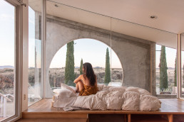The interior of the Sky Suite AirBnb at Arcosanti featuring incredible views to the high desert landscape | Bare Escape