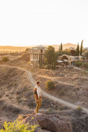 Views from afar of the Arcosanti compound featuring Nash from The Nomadic People | Bare Escape